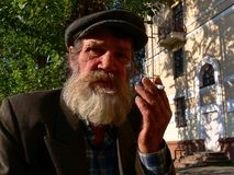 Man smoking in the street Stock Images