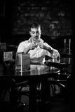 Man smoking at the table Royalty Free Stock Photos
