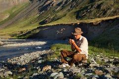 Man smoking tobacco-pipe Royalty Free Stock Photography