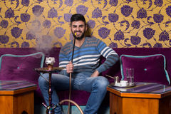 Man Smoking The Traditional Hookah Royalty Free Stock Photography