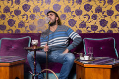 Man Smoking The Traditional Hookah Royalty Free Stock Images
