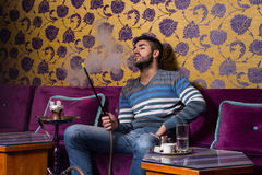 Man Smoking The Traditional Hookah Stock Images