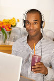Man With a Smoothie and Laptop Royalty Free Stock Photo