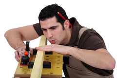 Man smoothing plank of wood Royalty Free Stock Photo