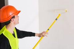 Man smoothing the wallpaper Royalty Free Stock Photos