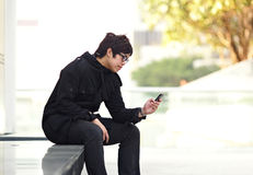 Man sms on cell phone Stock Image