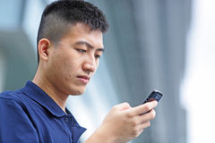 Man sms on mobile phone Royalty Free Stock Photos