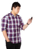 Man sms on mobile phone Stock Images