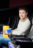 Man With Snacks At Cinema Theater Royalty Free Stock Photography