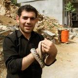 A man with snakes Stock Photos