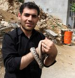 A man with snakes Royalty Free Stock Photo