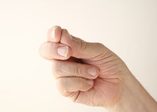 Man snapping his fingers Stock Images