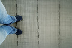 Man with sneaker on the escalator Royalty Free Stock Image