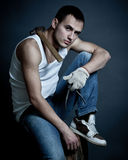 Man in sneakers with instruments Royalty Free Stock Images