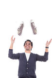 Man with sneakers smiling about sales discount Royalty Free Stock Photo