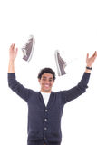 Man with sneakers throwing them away Royalty Free Stock Image
