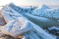 Man sneaks past the frozen sea. Ice hummocks Stock Photo