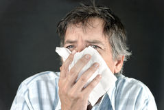 Man Sneezes Into Tissue Front Stock Photos