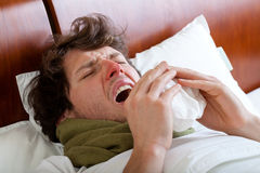 Man sneezing Stock Image