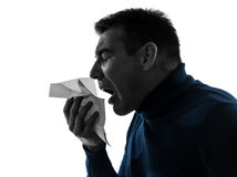 Man sneezing silhouette portrait Stock Images