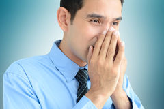 A man sneezing  without a tissue or cloth Stock Image