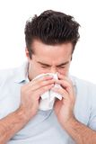 Man sneezing into a tissue Royalty Free Stock Images