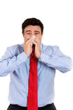 Man sneezing, wiping nose Stock Photography