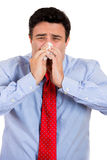 Man sneezing, wiping nose Royalty Free Stock Image