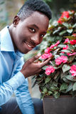Man  sniffing the flowers Stock Image