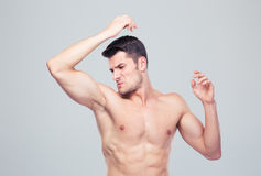 Man sniffing his armpit Royalty Free Stock Photos