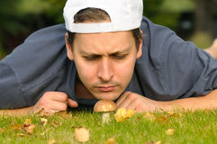Man sniffing mushroom Royalty Free Stock Photo