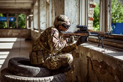 Man sniper with automatic rifle with a telescopic sight Stock Images