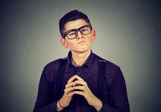 Man with snobbish face expression. Young man with snobbish face expression royalty free stock photography