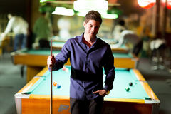 Man with snooker stick Royalty Free Stock Photo