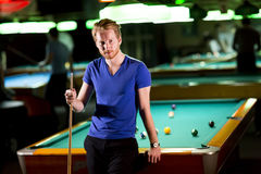 Man with snooker stick Stock Photography