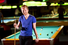 Man with snooker stick Royalty Free Stock Photography