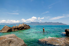 Man with snorkel in lagoon. Man with snorkel in turquoise sea lagoon in Vietnam Stock Images