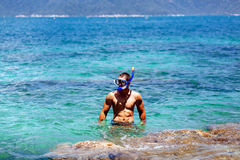 Man with snorkel in lagoon Royalty Free Stock Photography