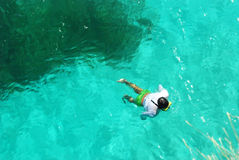 Man Snorkeling. Man Snorkeling in blue water in Philippines, Siquijor Stock Photo