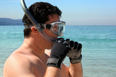 Man snorkeling. Man is about to go snorkeling in the ocean Stock Photo
