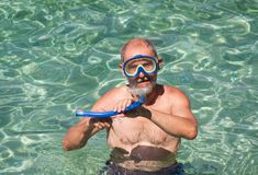 Man snorkeling in the background sea Stock Image