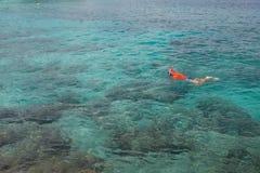Man snorkeling in blue ocean Stock Image