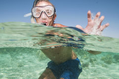 Man snorkeling on a coral reef over under shot Stock Photo