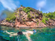 Man snorkeling in crystal clear water in Thailand. Royalty Free Stock Photo