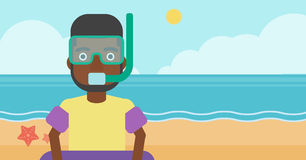 Man with snorkeling equipment on the beach. Stock Image