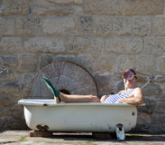 Man with snorkeling gear lying in the bathtub Royalty Free Stock Photos