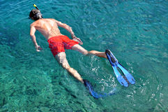 Man snorkeling in a tropical sea Stock Photo