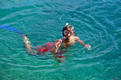 Man snorkeling in a tropical sea Stock Images