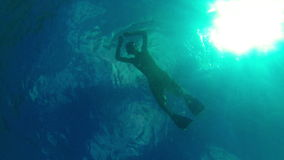 Man snorkeling in the warm sea. View from the bottom of the sea. Video 1920x1080 - Man snorkeling in the warm sea. View from the bottom of the sea stock video footage