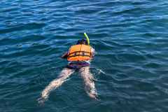 The man snorkelling in andaman sea at phi phi islands, Thailand Royalty Free Stock Photography